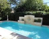 Geometric pool with fountain and raised wall.JPG