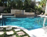 Geometric pool with raised spa and pool landscaping.JPG