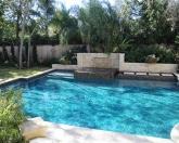 Geometric pool with raised spa.JPG
