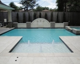 Geometric pool with raised wall and bubblers.JPG